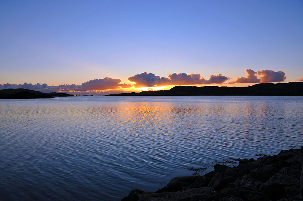 Picture of some beautiful October late afternoon light with sunset approaching over a sea loch