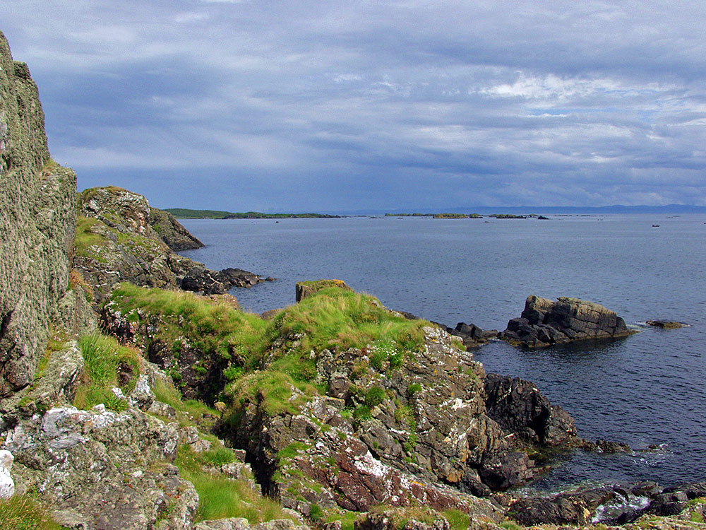 Picture of a rocky coastline with some skerries in the distance