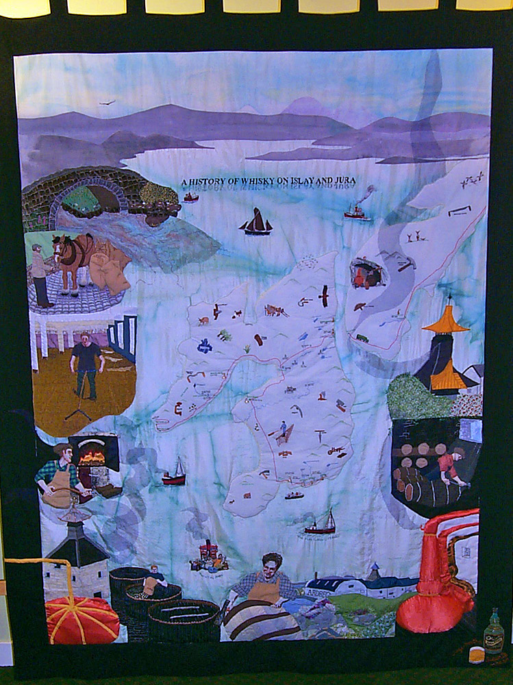 Picture of a quilt depicting the history of whisky making on Islay and Jura