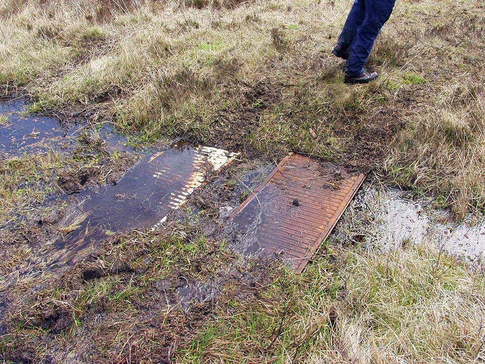Picture of some old radiators recycled as bridges on a boggy landscape