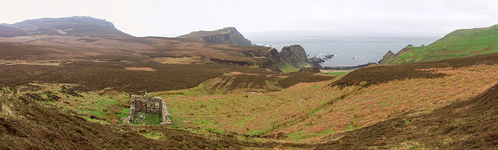 Panoramic picture of a coastal landscape with cliffs on a rainy day