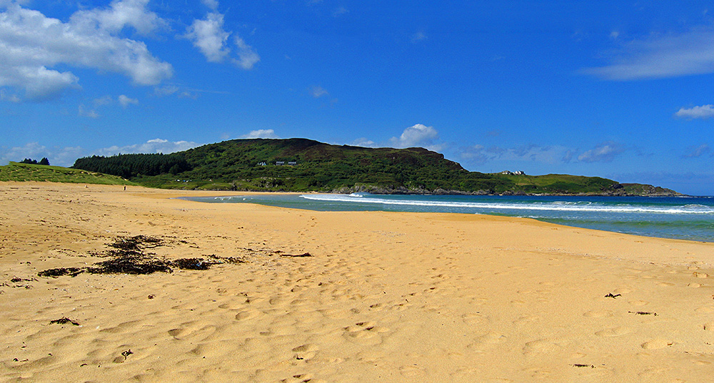 Panoramic picture of a beach in a bay seen from the beach