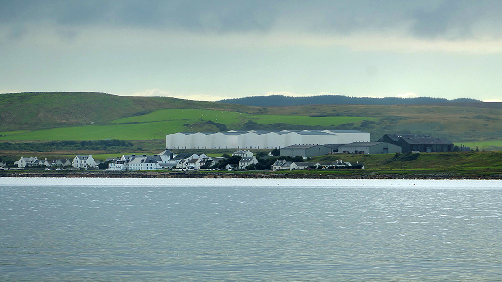 Picture of a coastal village with a distillery and the distillery warehouses