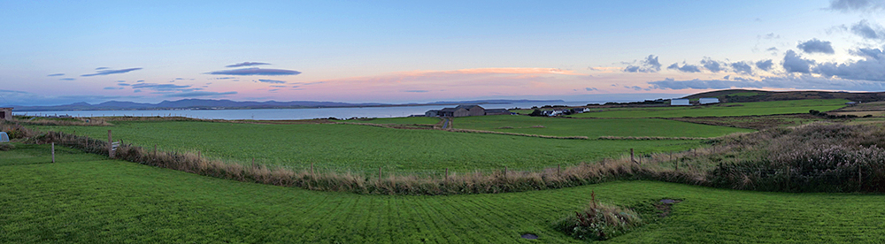 Panoramic picture of a view from a hillside over a sea loch
