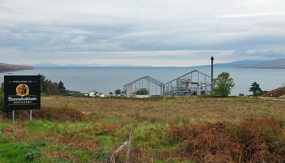 Picture of the biomass plant under construction at Bunnahabhain distillery in October 2021, seen from the road