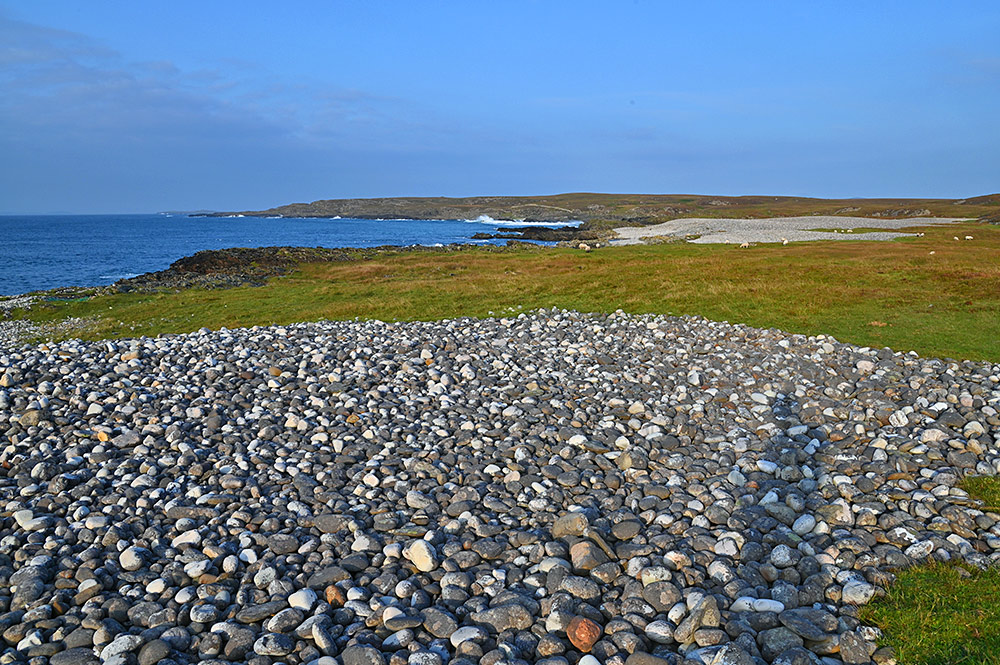 Picture of two pebble beaches in some mild September evening sun